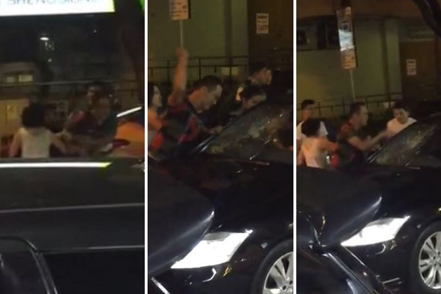 A man was captured on video punching a car's windscreen multiple times, denting it and causing cracks to form.
