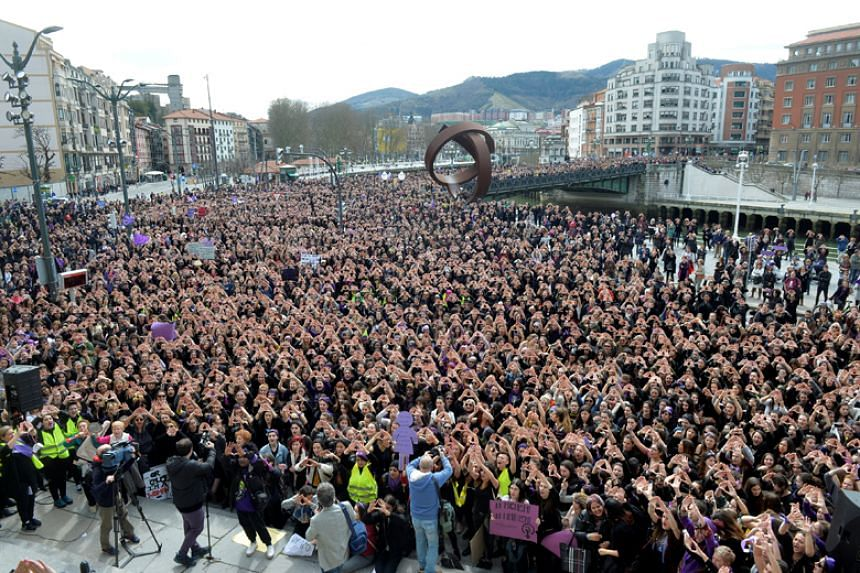 Protesters form triangles with their hands during a demonstration for women's rights on International Women's Day in Bilbao, Spain, on March 8, 2018.