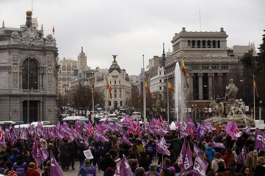Demonstrators gather at the Cibeles Square to support International Women's Day in Madrid on March 8, 2018.