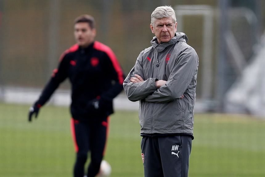 Arsenal manager Arsene Wenger during training yesterday, as his side prepared to meet AC Milan in a Europa League tie today. A growing pay divide is said to have split the dressing room, while an overwhelming majority of the Arsenal Supporters' Trust