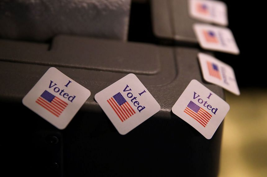 """""""I voted"""" stickers are displayed on a voting machine in Mountain Brook, Alabama."""