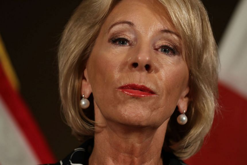 Betsy DeVos speaks to the media about her visit to Marjory Stoneman Douglas High School.