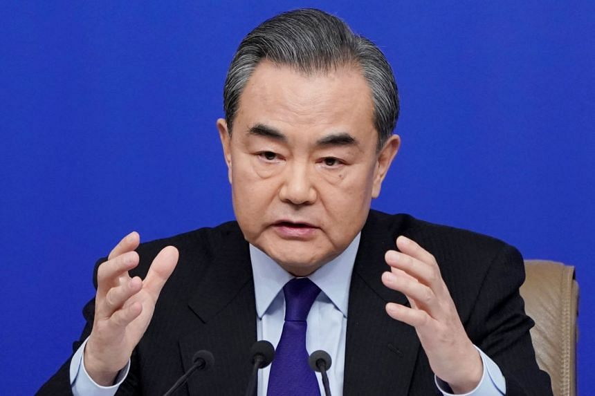 China's Foreign Minister Wang Yi attends a news conference during the ongoing National People's Congress in Beijing, China, on March 8, 2018.