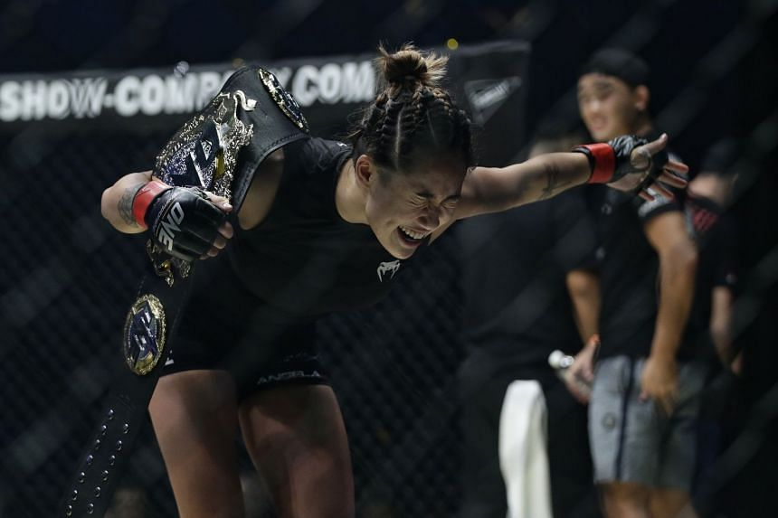 Angela Lee retains her One Championship atomweight title after beating Brazil's Istela Nunes in the One Championship's Dynasty of Heroes fight night at Singapore Indoor Stadium on May 26, 2017.