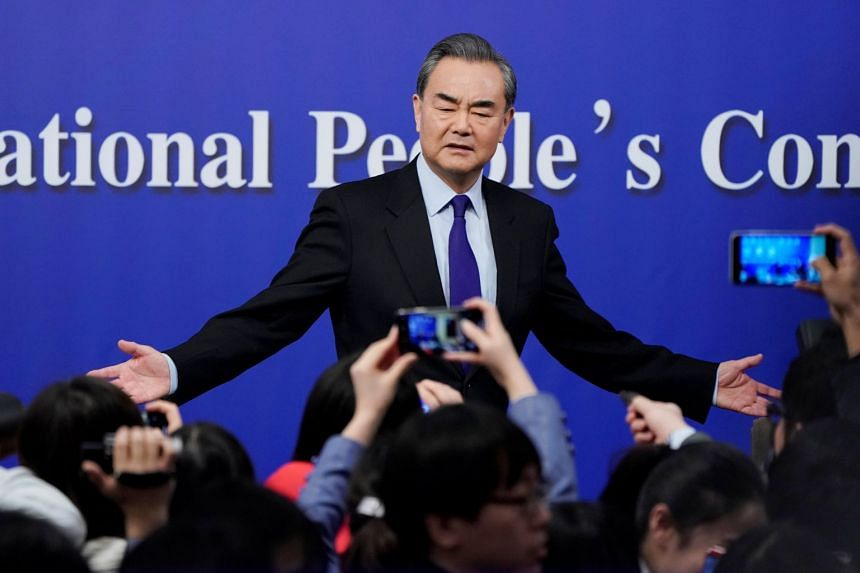 China's Foreign Minister Wang Yi speaks to the media after a news conference during the National People's Congress in Beijing on March 8, 2018.