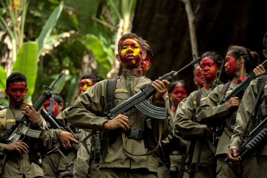 Guerrillas of the New People's Army (NPA) in formation in the Sierra Madre mountain range, located east of Manila on July 30, 2017.