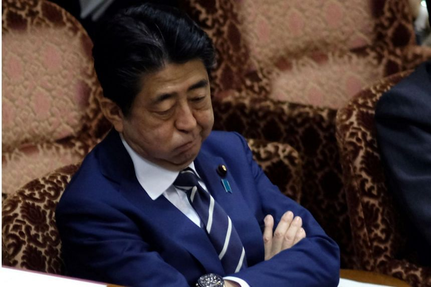 Japan's Prime Minister Shinzo Abe attends an upper house budget committee session of parliament in Tokyo on March 8, 2018.