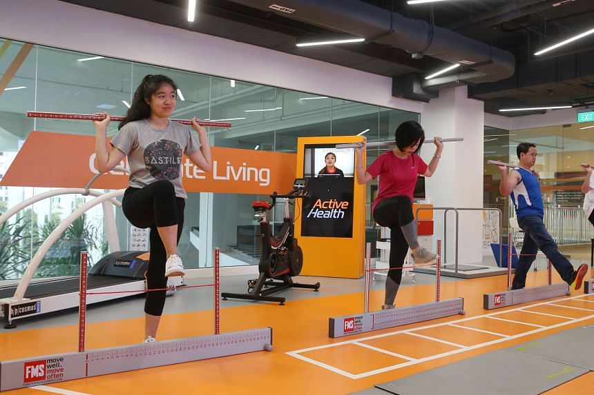 (From left) The Straits Times' Cheryl Tee, Senior Minister of State Sim Ann and Berita Harian's Farid Hamzah trying out some exercises at the Active Health Lab in Heartbeat@Bedok on Feb 28, 2018.