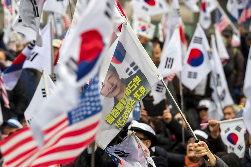 Supporters of former South Korean president Park Geun Hye protest in front of a court after prosecutors sought a 30-year jail term for the ousted president in Seoul, South Korea, on Feb 27, 2018.