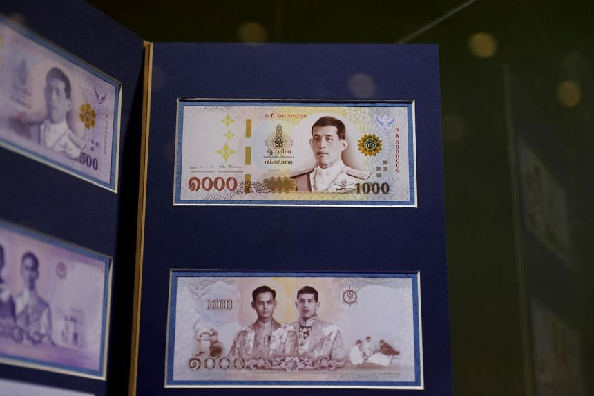 A one thousand baht bank note featuring Thailand's King Maha Vajiralongkorn is unveiled during a news conference at the Bank of Thailand headquarters in Bangkok on March 8, 2018.