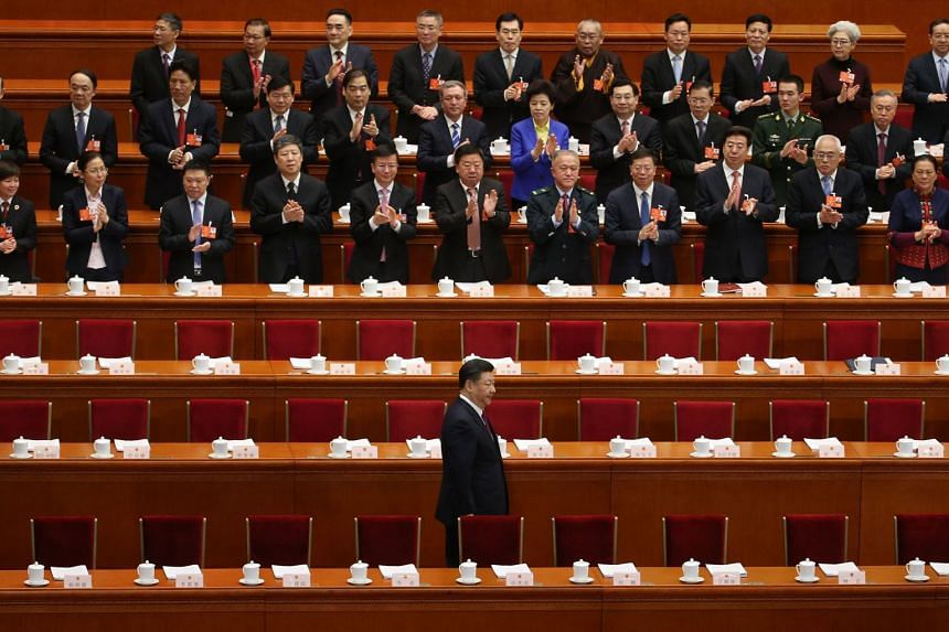 Chinese President Xi Jinping arrives for the opening of the first session of the 13th National People's Congress at the Great Hall of the People in Beijing, on March 5, 2018.