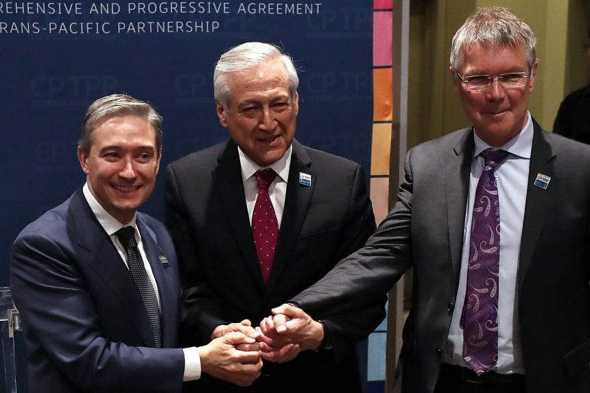 Chile's Foreign Affairs Minister Heraldo Munoz (centre), Canadian Trade Minister Francois-Philippe Champagne (left) and New Zealand Trade Minister David Parker make a joint statement before signing the agreement in Santiago, Chile.