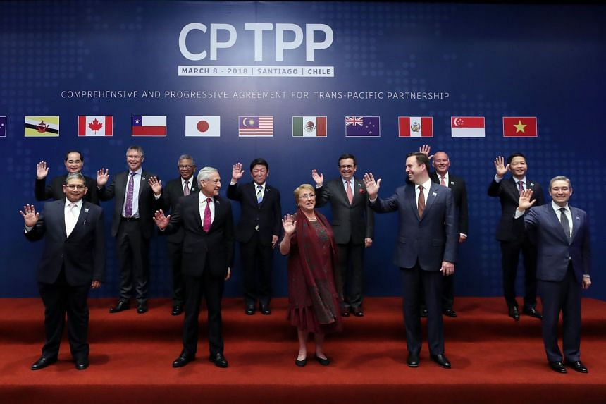 Representatives of the 11 countries pose for the family picture before signing the CPTPP pact.