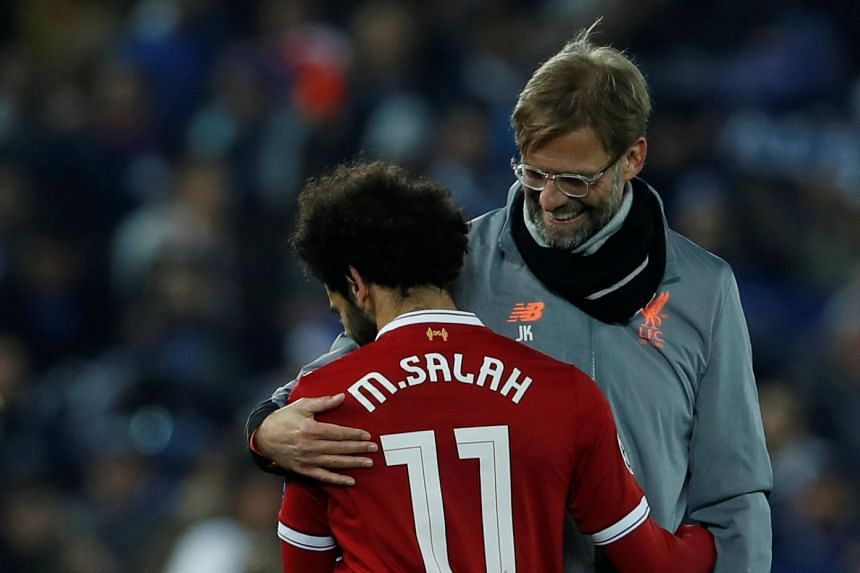 Klopp and Liverpool's Mohamed Salah after a Champions League match against FC Porto.
