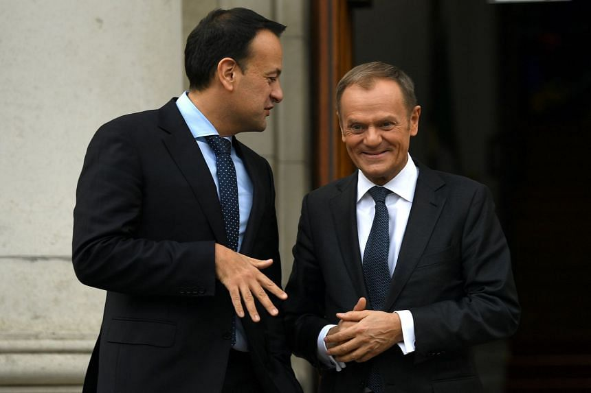 Leo Varadkar greets Donald Tusk at government buildings in Dublin, Ireland.