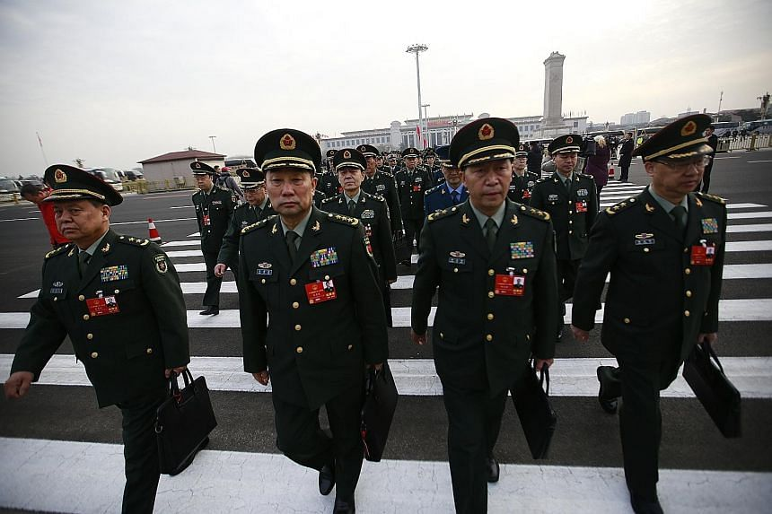 Military delegates arriving for the 13th National People's Congress in Beijing on Monday.
