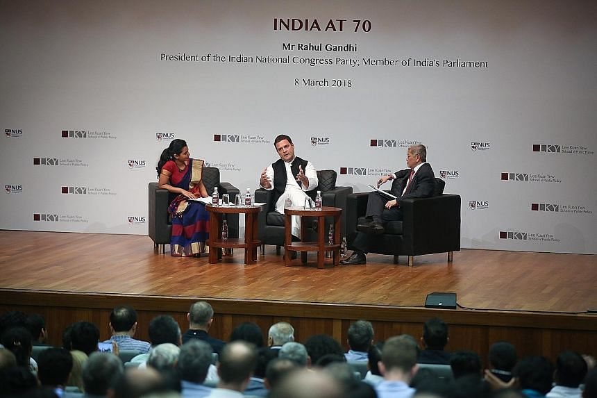 Congress party chief Rahul Gandhi with Lee Kuan Yew School of Public Policy acting dean Danny Quah and graduate student Pallavi Rachel George at the dialogue yesterday.