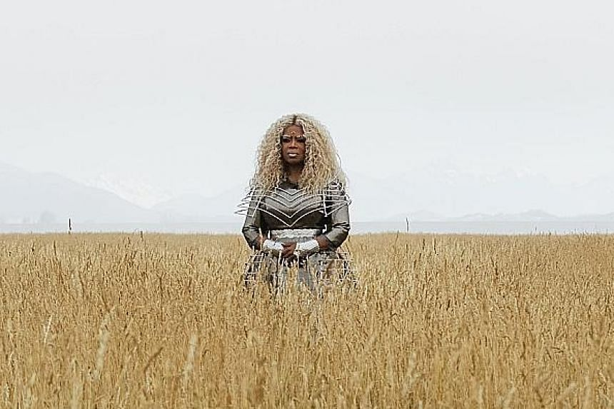 (From far left) Reese Witherspoon and Storm Reid in A Wrinkle In Time, which also stars Oprah Winfrey (above) as a supernatural being embodying magical thinking.