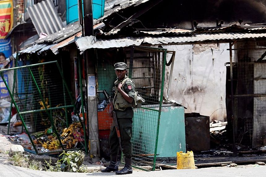 A Muslim man from the Moor community surveying the damage to his business, which was attacked and looted in Pallekele town in Kandy, some 117km from Colombo, on Wednesday.