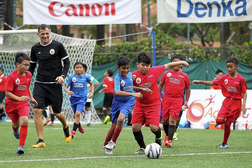 Children at the ActiveSG Football Academy with former national player Aleksandar Duric. More academies in different sports are in the pipeline.
