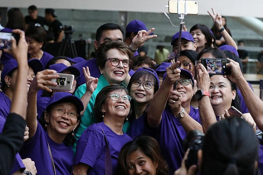 Women's Tennis Association founder Billie Jean King having a wefie taken with volunteers of the WTA Singapore yesterday.