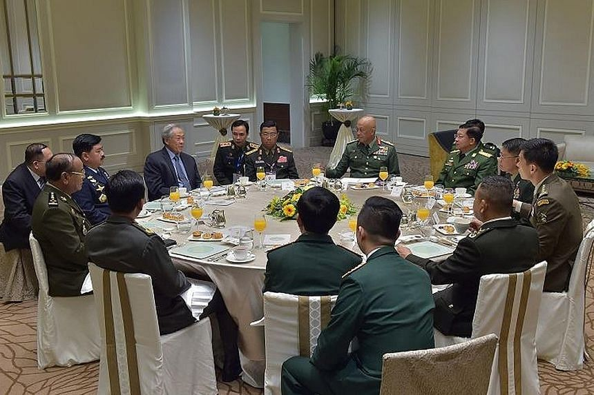 The Asean defence forces chiefs having breakfast with Defence Minister Ng Eng Hen (in blue shirt and tie) yesterday, during which they discussed regional security issues and the Asean militaries' agenda for the year ahead.