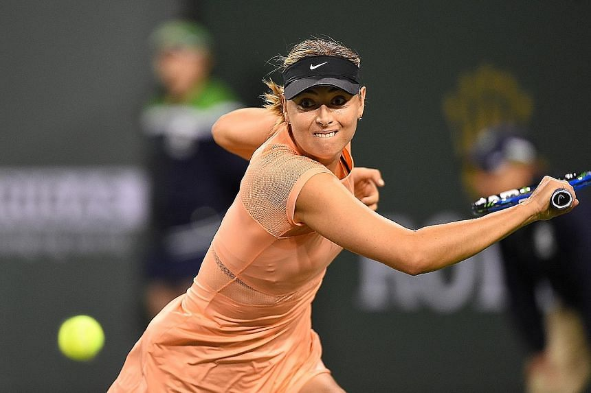 Maria Sharapova hitting a return against Naomi Osaka during their first-round match at Indian Wells. The former world No. 1 dropped serve five times in her 6-4, 6-4 defeat by the Japanese world No. 44. The Russian was also knocked out in the opening