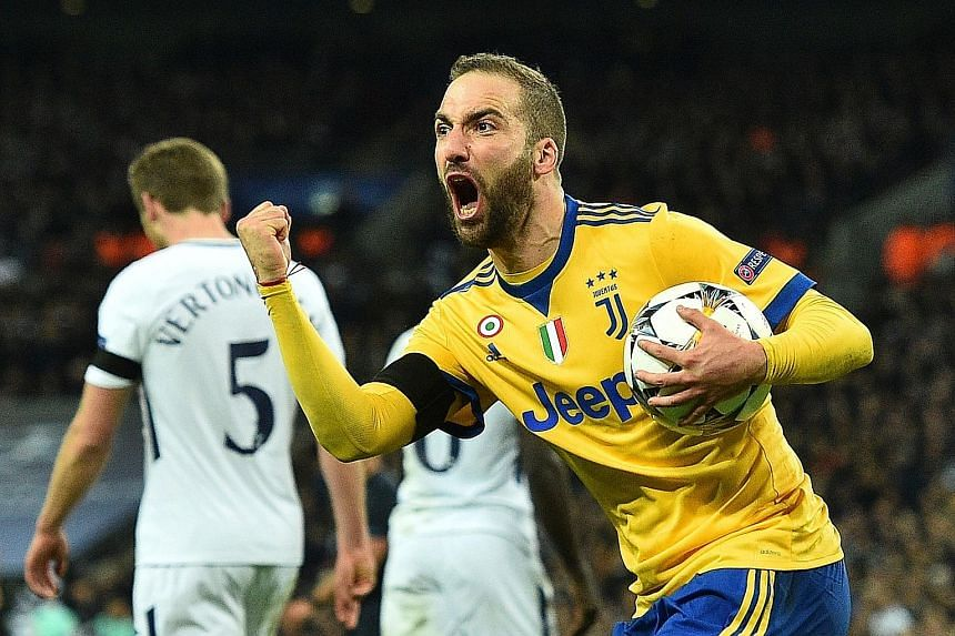 Juventus striker Gonzalo Higuain grabbing the ball for a quick restart after scoring the equaliser against Tottenham, his third goal of the tie, to drag the Italian champions back into the game. Paulo Dybala's winner just three minutes later was enou