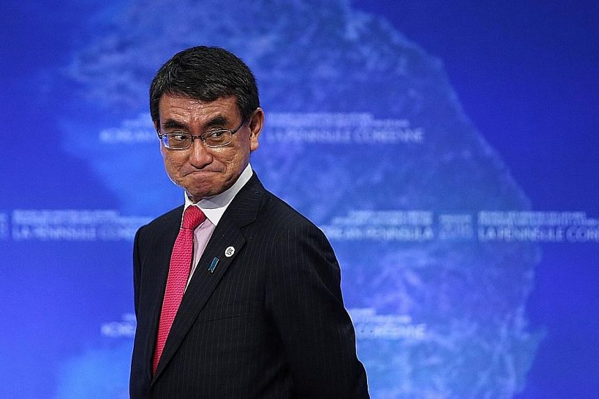 """Mr Taro Kono at a foreign ministers' meeting in Vancouver in January. At yesterday's ministerial conference, he said that """"substandard infrastructure will not only inhibit inclusive and sustainable development, but it could even become bottlenecks to"""