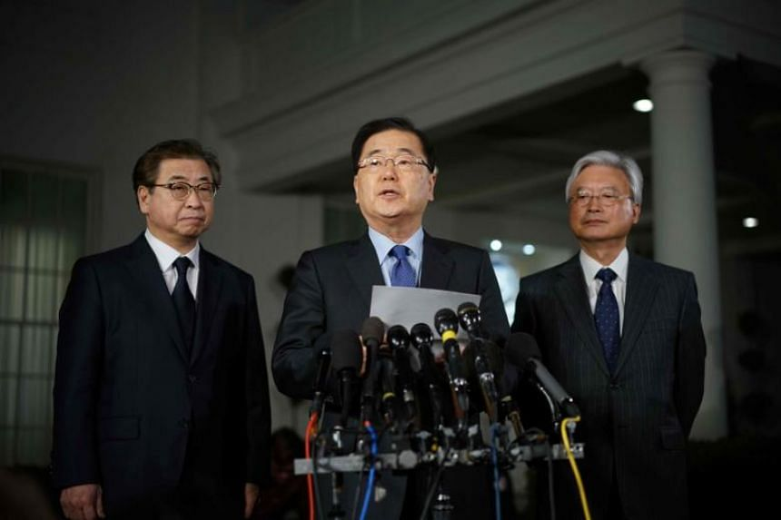 South Korean National Security Adviser Chung Eui Yong (centre) briefing reporters outside the West Wing of the White House, announcing North Korean leader Kim Jong Un's offer to meet US President Donald Trump, on March 8, 2018.