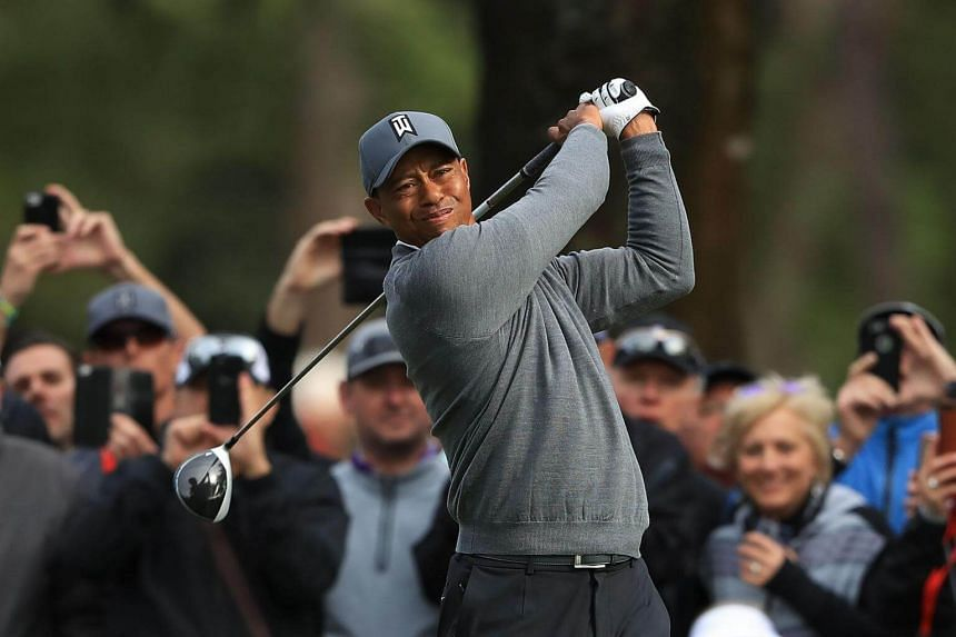 Tiger Woods plays his shot from the 14th tee during the first round of the Valspar Championship, on March 8, 2018.