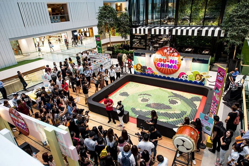 DreamWorks KouKou festival kicked off at CapitaLand Malls' Raffles City with a celebration of a Shrek mosaic created with over 3,000 cups of matcha. The completion of this mosaic set a new record in the Singapore Book of Records. PHOTO: CapitaLand Ma