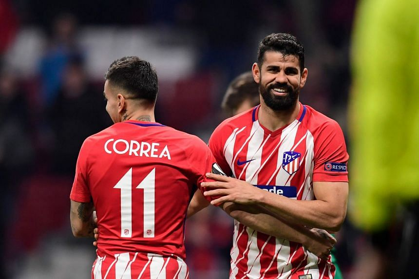 Diego Costa (right) celebrates with Angel Correa after scoring.