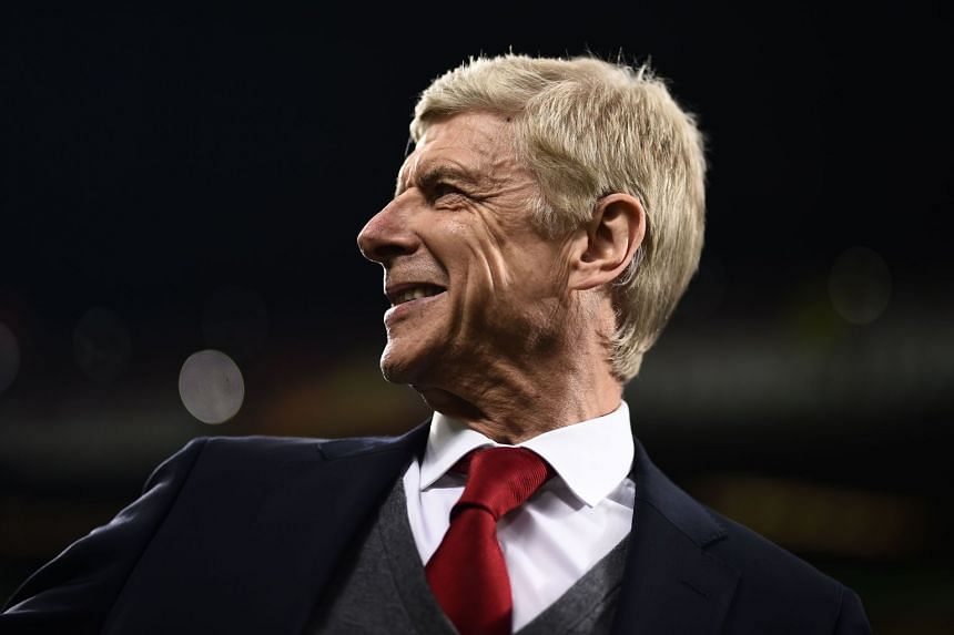 Arsenal's Wenger looks on during the match against Milan.