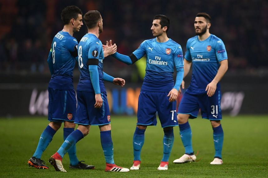 Henrikh Mkhitaryan (centre) celebrates with team mates at the end of the match.