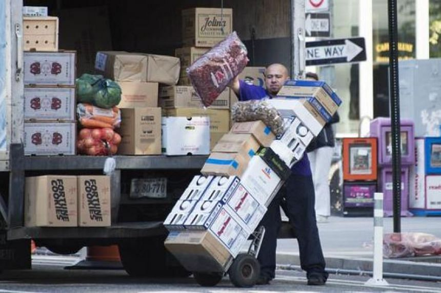 A worker unloads groceries in Washington, DC, in this Oct 6, 2014, file photo.