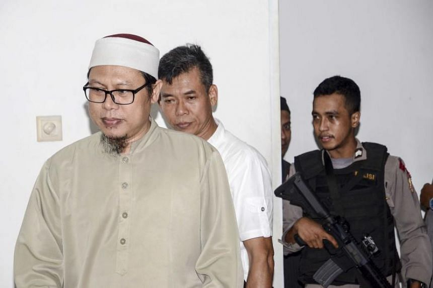 Indonesian Zainal Anshori (left) enters a court room prior to his trial in Jakarta on Feb 12, 2018.