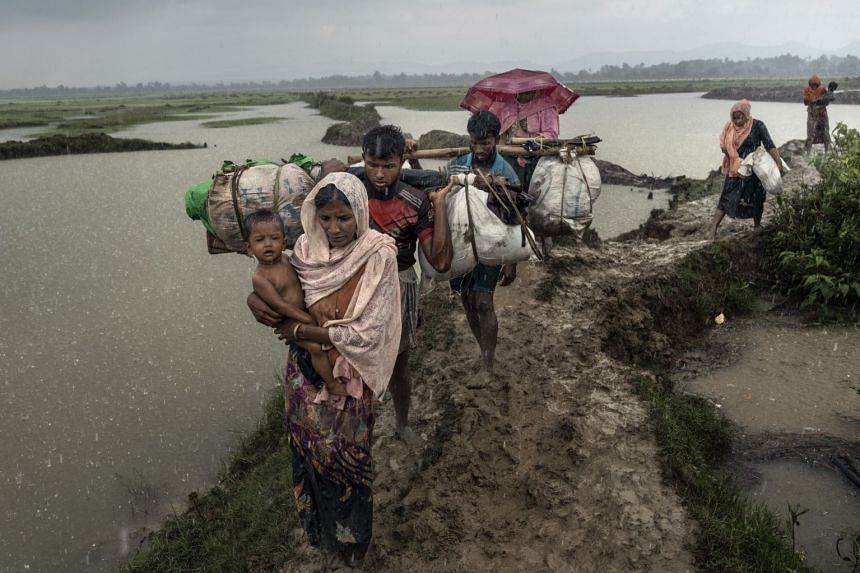 Rohingya refugees after crossing the Naf River that separates Myanmar and Bangladesh in September 2017.