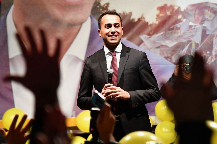Five Star  leader Luigi Di Maio gestures as he addresses supporters on March 6, 2018.