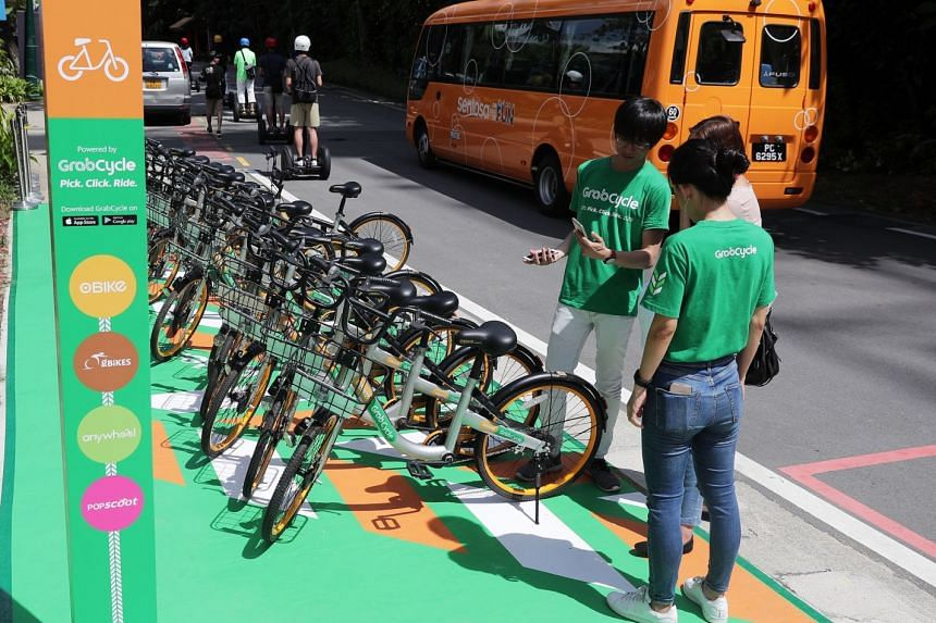 """Grab has partnered Sentosa Development Corporation to roll out more than 10 dedicated GrabCycle parking areas across Sentosa to deter indiscriminate parking, as part of a broader """"strategic partnership"""" between the two."""