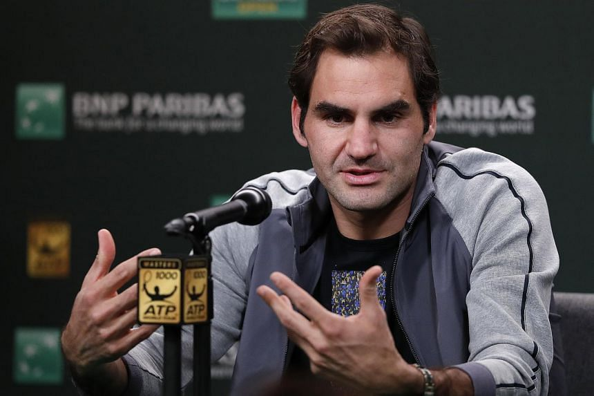 Roger Federer speaks to reporters at a press conference for the BNP Paribas Open, on March 8, 2018.