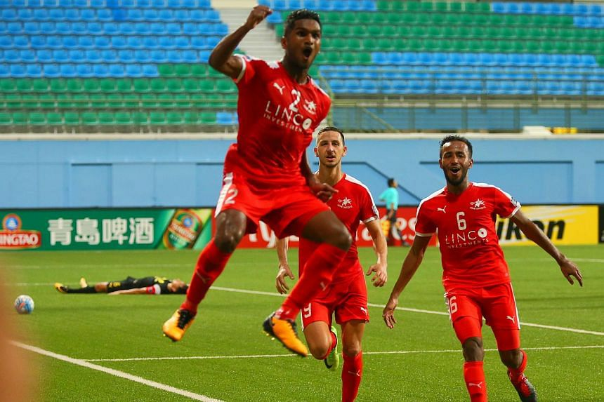 Home United midfielder Hariss Harun jumping for joy after scoring the winner as Abdil Qaiyyim (No. 6) and Stipe Plazibat join in the celebration in the first leg of the Asian Football Confederation (AFC) Cup Asean final, on Aug 2, 2017.
