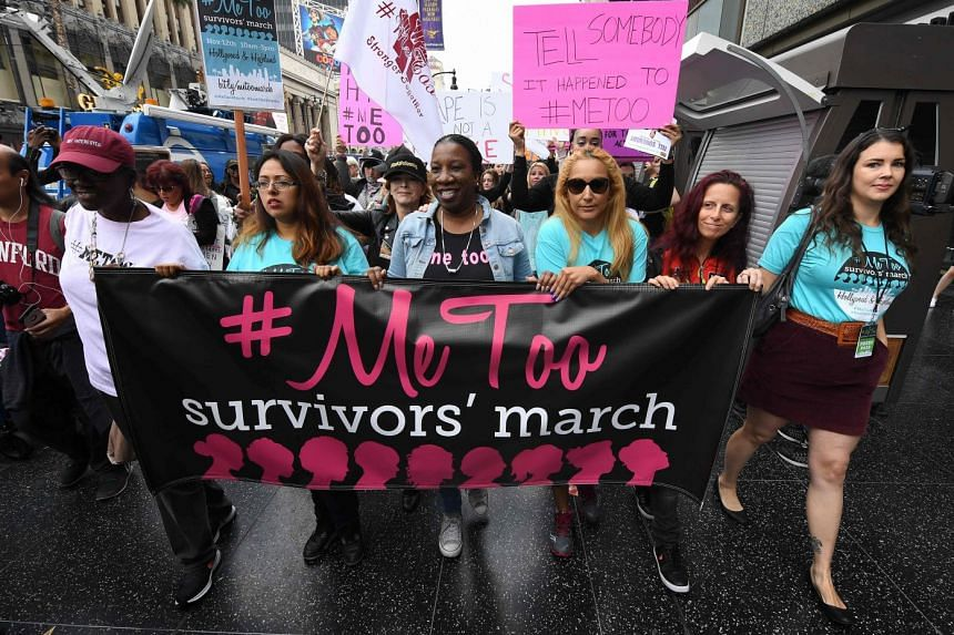 Survivors of sexual harassment, sexual assault, sexual abuse and their supporters protest during a #MeToo march in Hollywood, California on Nov 12, 2017.