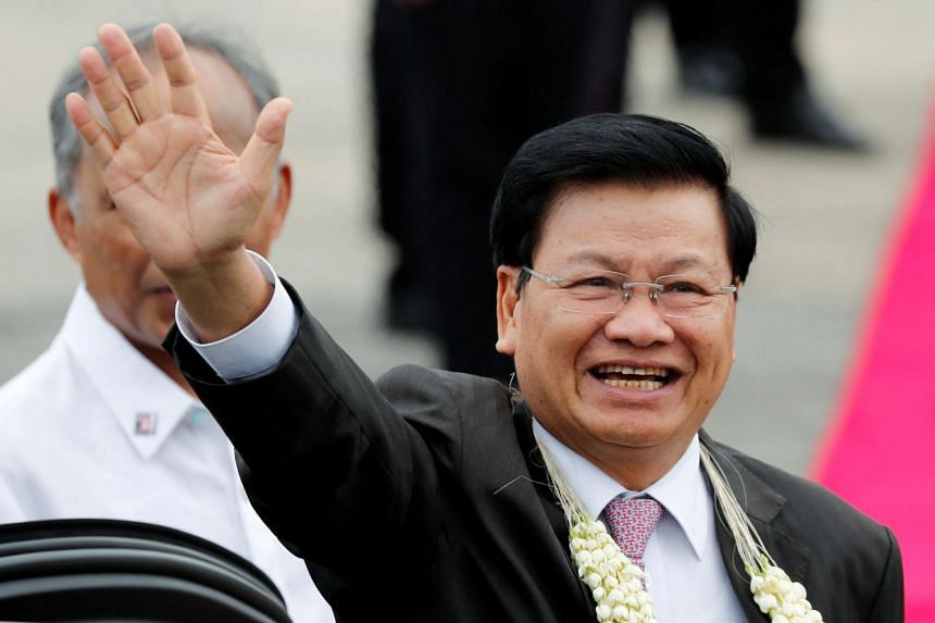 Laos Prime Minister Thongloun Sisoulith waves to the crowd upon his arrival to attend the Asean Summit and related meetings in Philippines on Nov 12, 2017.