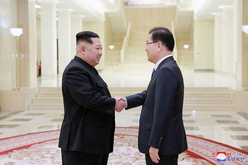 In a photo provided by the North Korean government, leader Kim Jong Un meets with South Korean envoy Chung Eui Yong in Pyongyang.
