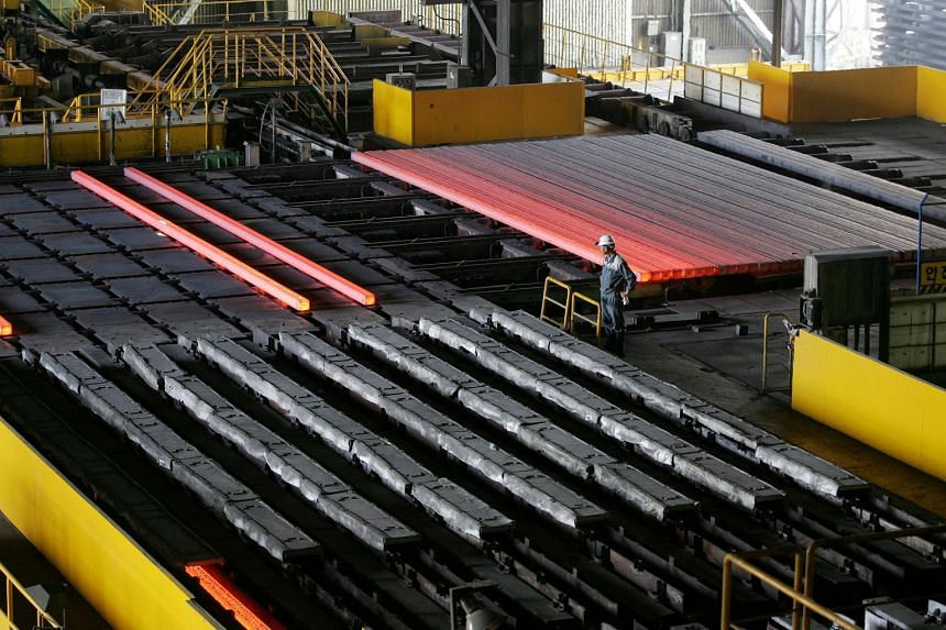 A factory worker inspects heated iron at bars Hyundai-Steel Co in Dangjin, South Korea. South Korea said it may file a complaint to the World Trade Organisation regarding US President Donald Trump's decision to impose tariffs on steel and aluminium i