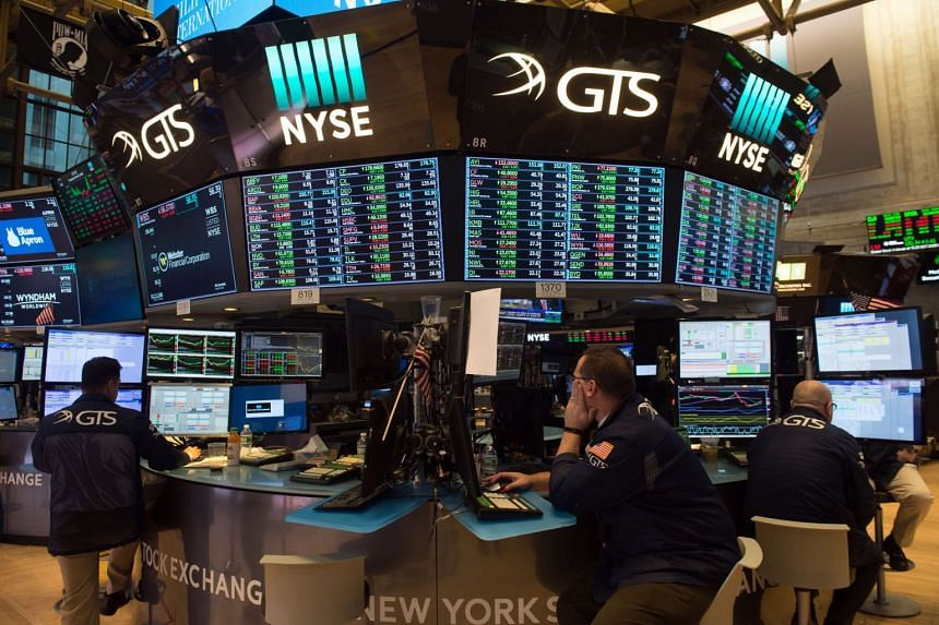Traders working on the floor at the closing bell of the Dow Industrial Average at the New York Stock Exchange, on March 8, 2018.