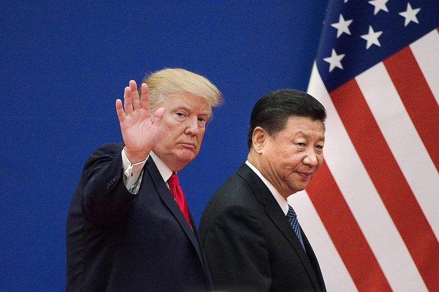 US President Donald Trump (left) and China's President Xi Jinping leaving a business leaders event in Beijing, on Nov 9, 2017.