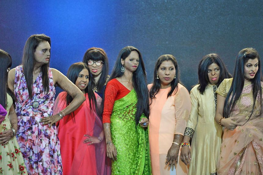 """Acid attack survivors pose during a fashion show as part of a campaign to spread the message """"Stop Acid Sale"""", in Thane, India, on Wednesday ahead of International Women's Day, which is celebrated on March 8 every year and commemorates the movement f"""