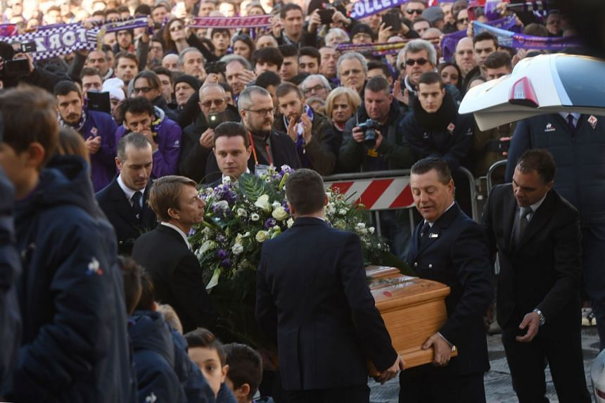 Astori's coffin is carried inside Santa Croce basilica for the funeral on March 8, 2018 in Florence.